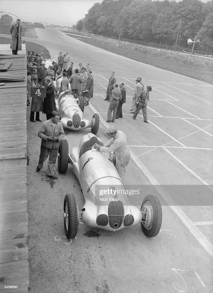 German cars in the pits at Donington Park in preparation for the International Donington Grand Prix Race