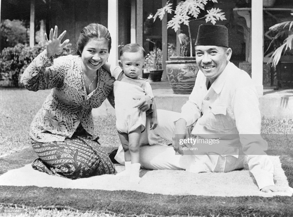 Batavia, Java, Indonesia- Dr. I.R. <a gi-track='captionPersonalityLinkClicked' href=/galleries/search?phrase=Sukarno&family=editorial&specificpeople=209275 ng-click='$event.stopPropagation()'>Sukarno</a>, Nationalist leader and President of the Indonesian government, with his wife and son, Guntur, shown at their home. The eyes of the entire world are on this man, who, although he was in power during the Japanese occupation, has managed to retain his authority. The peace and prosperity of 80,000,000 Indonesians depend on his decisions.