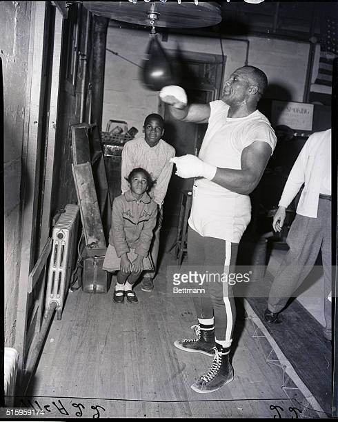 3/11/1953Pleasantville New Jersey Jersey Joe Walcott gives his daughter Carol and son Vincent a demonstration of how he'll go about regaining the...