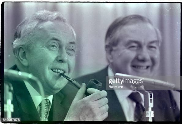 3/11/1975Dublin Ireland Another familiar personality most always seen with a pipe in hand is British Prime Minister Harold Wilson who breaks into a...
