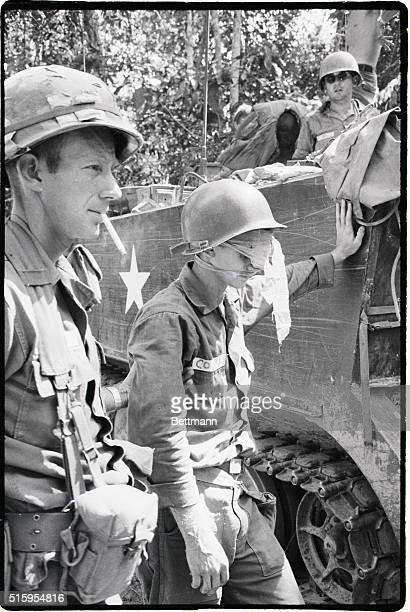 3/13/1966War Zone D South Vietnam A trooper with the First Infantry Division comforts his buddy who was wounded when the armored personnel carrier in...