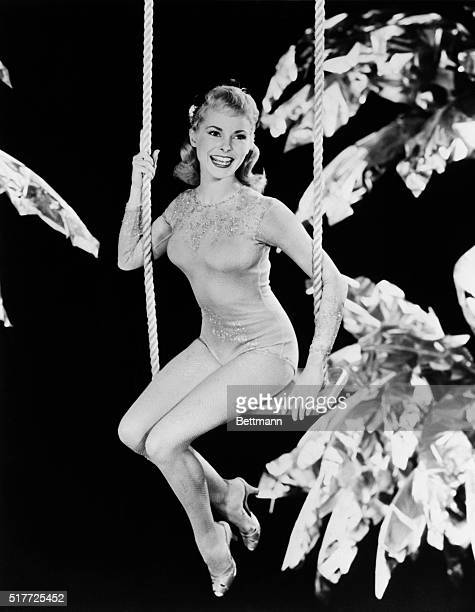 3/14/55Hollywood California What with Spring almost here pretty blonde star Janet Leigh perches on a swing to remind us that summer is not far behind...