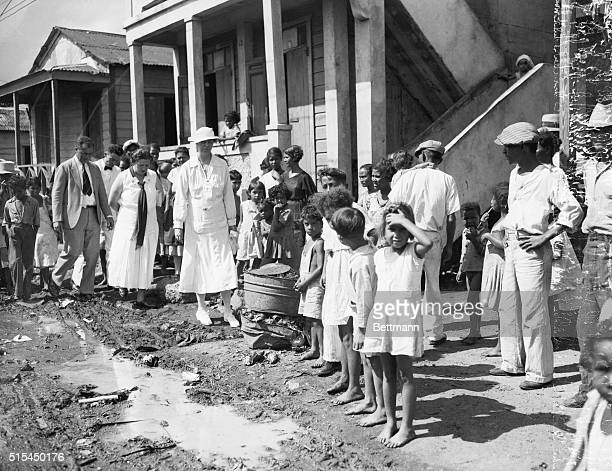 3/15/1934San Juan Puerto Rico Mrs Franklin D Roosevelt wife of the President standing at the edge of a pool of dirty water swarming with flies in the...