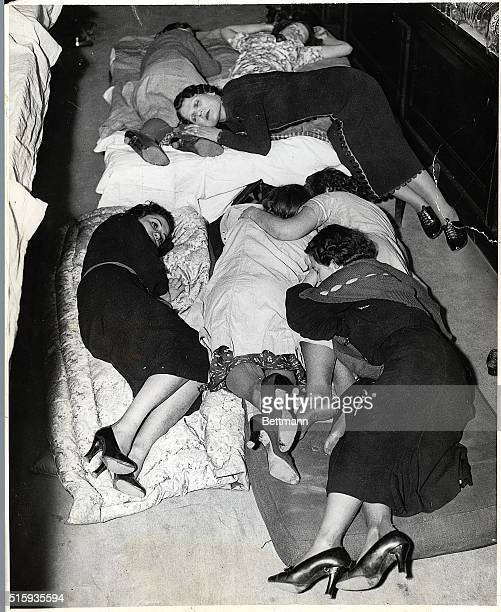 3/15/1937New York NYAfter a weary day of sitdown striking in the 14th Street fiveandtencent store girl employees relax in the arms of morpheus The...