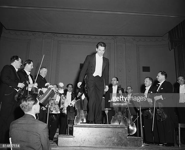 Conductor Herbert Von Karajan of the Berlin Philharmonic Orchestra bows to the audience after leading the orchestra in its first concert at Carnegie...