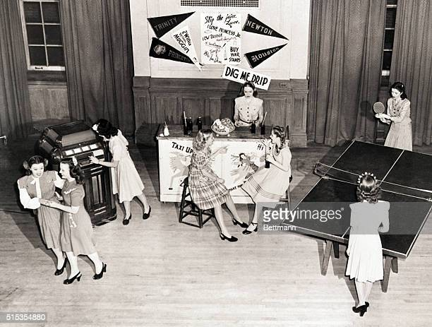 3/18/1945New York NY At the Teentimers' canteen fashion show the kids go to town on all fronts in their new duds All the dresses designed by Grace...