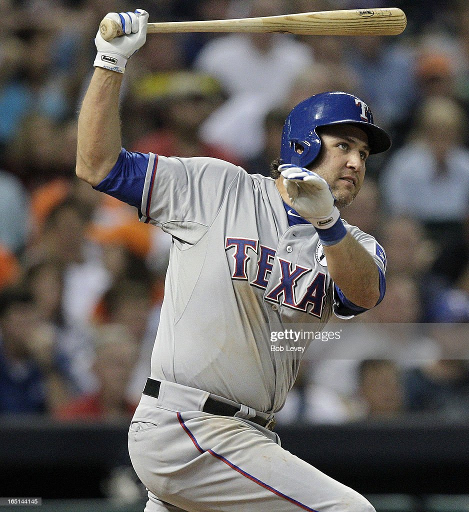 HOUSTON, TX - MARCH 31<a gi-track='captionPersonalityLinkClicked' href=/galleries/search?phrase=Lance+Berkman&family=editorial&specificpeople=167176 ng-click='$event.stopPropagation()'>Lance Berkman</a> #27 of the Texas Rangers singles in the sixth inning against the Houston Astros at on Opening Day at Minute Maid Park on March 31, 2013 in Houston, Texas.