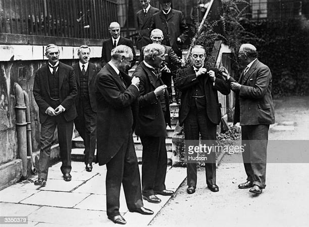 British prime minister Ramsay MacDonald at No 10 Downing Street with members of the cabinet of the National Government he formed during the financial...