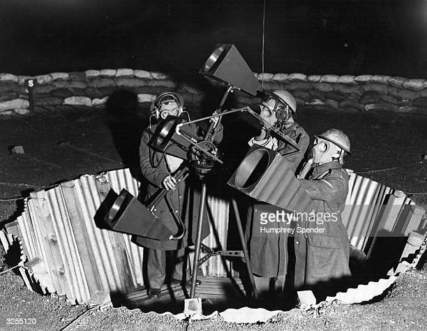 A group of Civil Defence workers man a searchlight in London in order to warn of possible night time bombing raids Original Publication Picture Post...