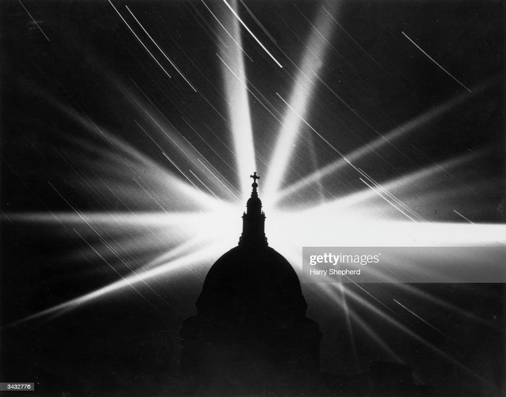 Searchlights over St Paul's Cathedral during The Blitz.