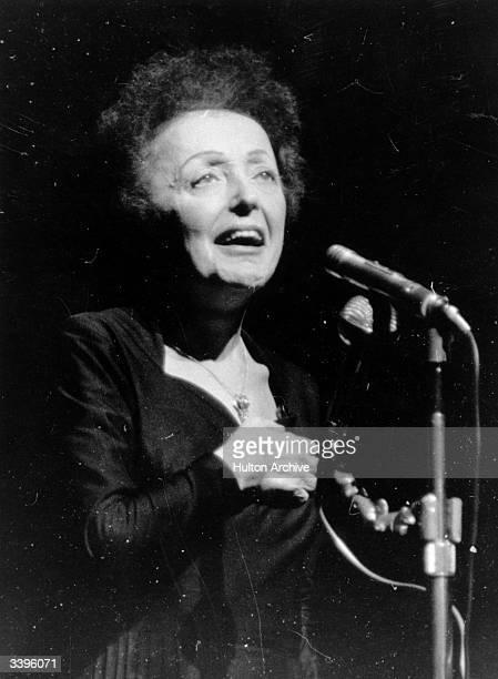 Parisian popular singer Edith Piaf performing at the Olympia Paris