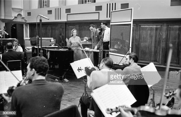 British singer Vera Lynn rehearsing her new radio show with an orchestra
