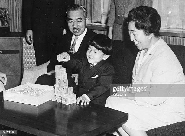 Emperor Hirohito of Japan with Empress Nagako and their grandson Prince Naruhito celebrate the New Year at the Imperial Palace in Tokyo