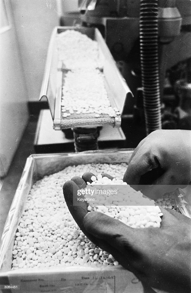 Production of the birth control pill at a factory in High Wycombe, Buckinghamshire. More than 400,000 British women now use oral contraceptives in order to prevent pregnancy.
