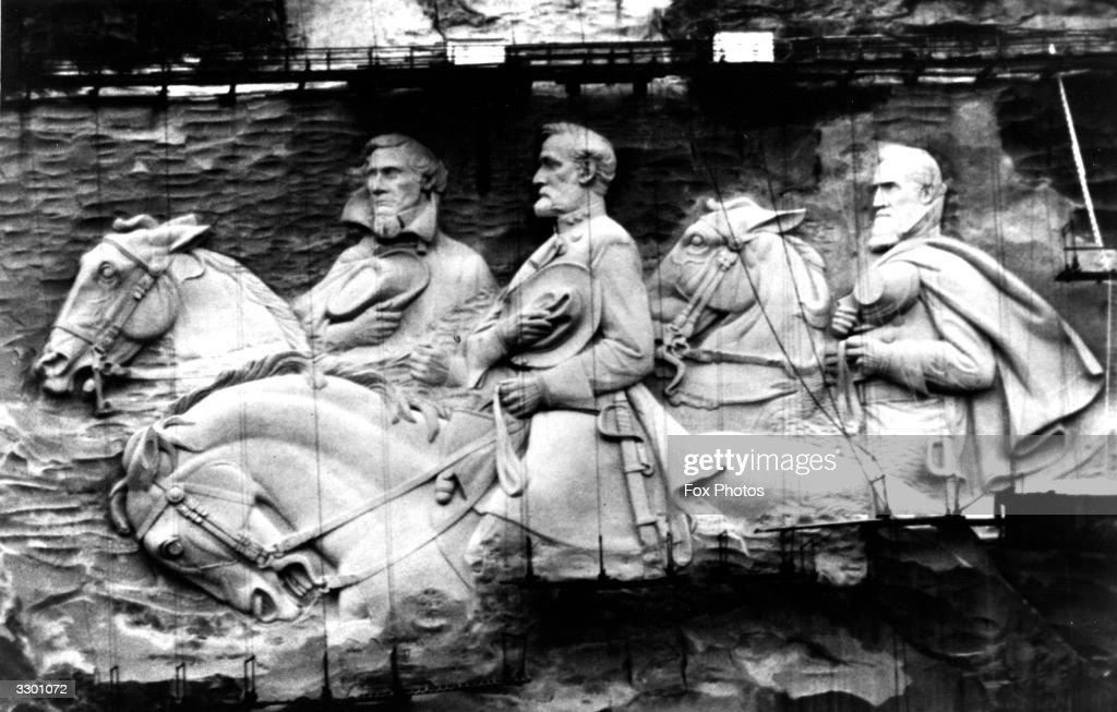 Giant stone mountain figures sculptured in granite rock on Stone Mountain Atlanta Georgia The figures represent Jefferson Davis the only President of...