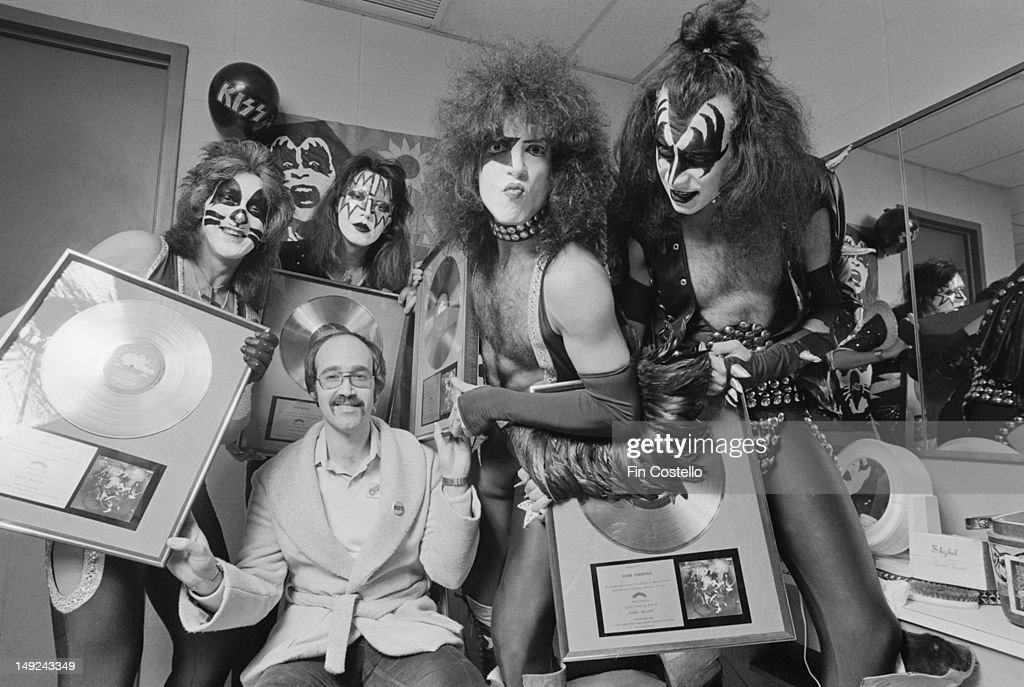 American rock band Kiss pose backstage holding gold discs at the Nassau Coliseum in Uniondale New York on 31st December 1975 Left to right Peter...