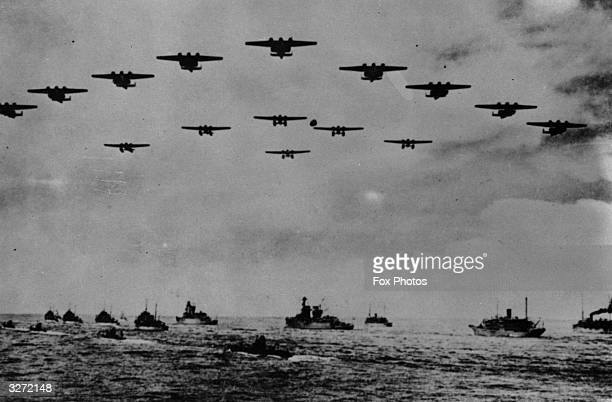 British ships carry troops withdrawn from the Malayan mainland under air cover to the island of Singapore
