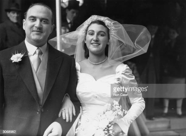 English publisher Arthur George Weidenfeld with his wife Jane Sieff after their wedding at the New West End Synagogue in Bayswater London