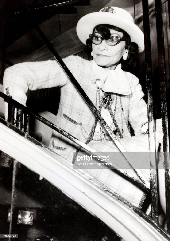 31st January 1969, A portrait French designer Coco Chanel who was the proprietress of the famous dressmaking firm as she is seated on a staircase