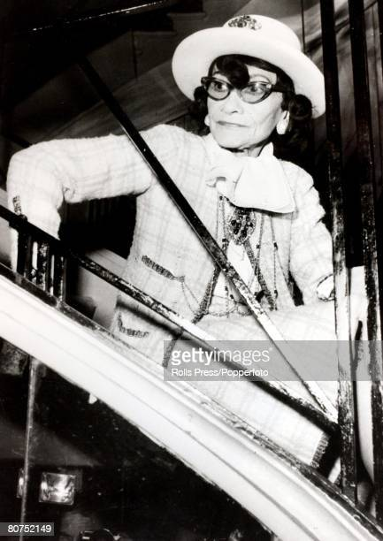31st January 1969 A portrait French designer Coco Chanel who was the proprietress of the famous dressmaking firm as she is seated on a staircase