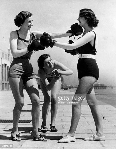 Girls try out a little boxing on the promenade at the seaside resort of Hastings in the south of England