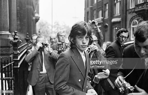 Surrounded by press photographers Mick Jagger arrives at the London law courts to appeal against his conviction on drug charges His sentence was...