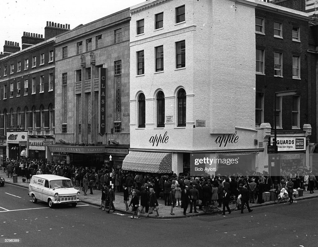A crowd of people queuing outside The Beatles' boutique 'Apple' in London's Baker Street, waiting for the doors to open after The Beatles decided that they were 'sick of being shopkeepers' and ordered that thousands of pounds worth of stock be given away free.