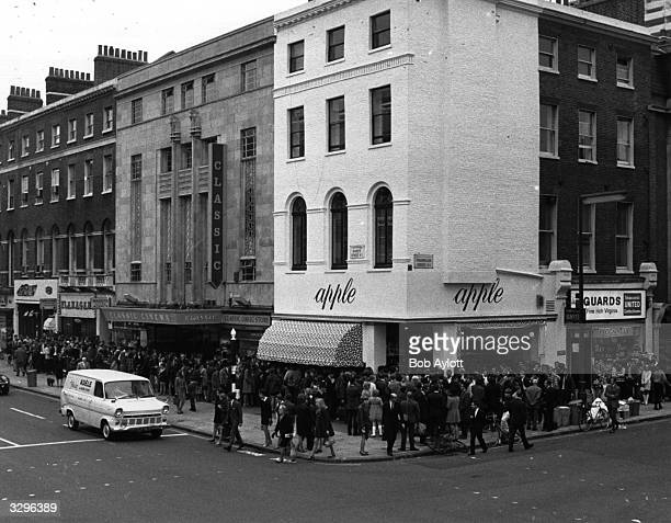 A crowd of people queuing outside The Beatles' boutique 'Apple' in London's Baker Street waiting for the doors to open after The Beatles decided that...