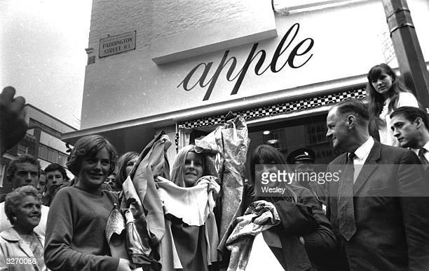 'Tired of being shopkeepers' The Beatles decide to give away thousands of pounds worth of stock from their boutique Apple in Baker Street London