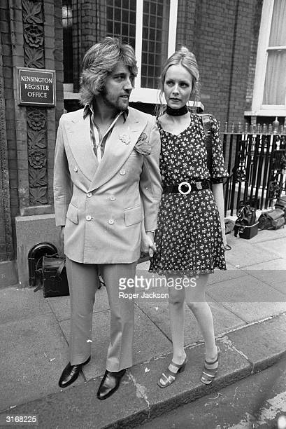 Fashion model Twiggy with her producer and manager Justin De Villeneuve at Kensington Register Office in London for the wedding of Cynthia Lennon and...