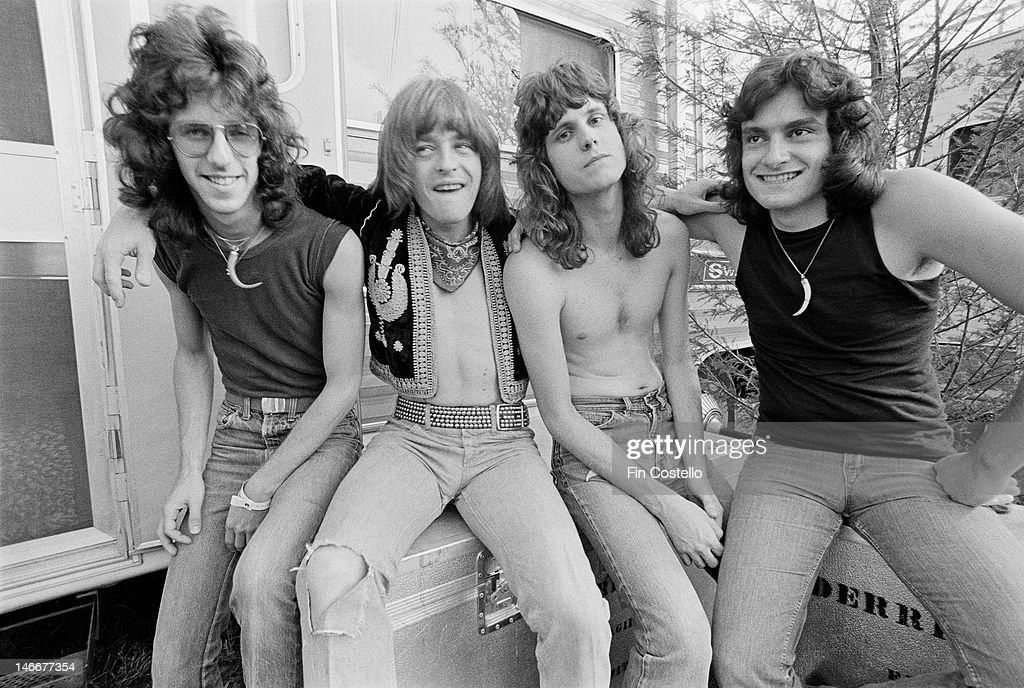 bassist Kenny Aaronson guitarist Rick Derringer guitarist Danny Johnson and drummer Vinny Appice from rock group Derringer posed backstage in Dayton...