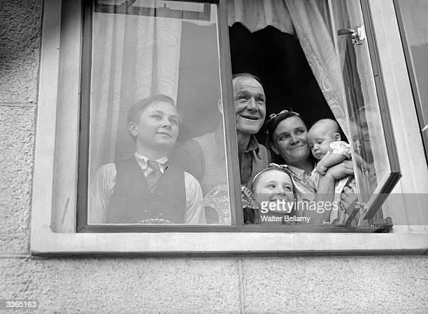John Atheis and his family enjoy the view out of their window in Millwall London