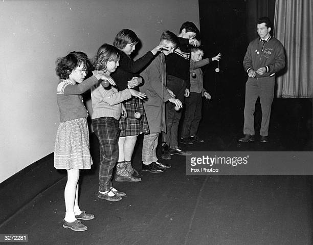 Line up of children with yoyos in their hands who are competing in a yoyo competition in London