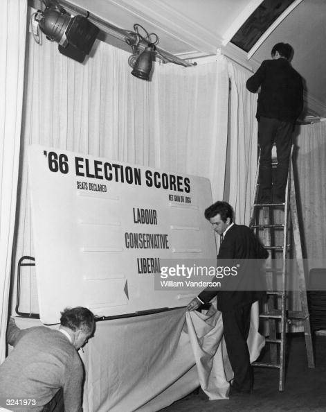 Three men busily preparing for the declaration of results of the 1966 General Election at Transport House the London Headquarters of the Labour Party