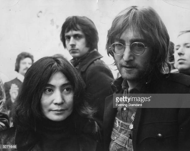 Rock singer songwriter John Lennon and his wife artist Yoko Ono at a gallery party