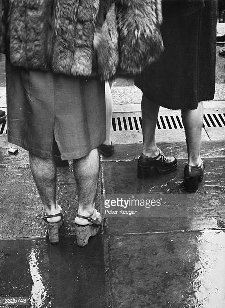 Legs of New Yorkers watching the Easter Sunday Parade on Fifth Avenue New York