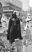 Darth Vader and two stormtroopers from the film 'Star Wars' stand menacingly over some road works in London's Oxford Street