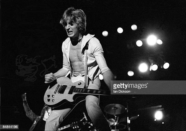 Guitarist Mick Ronson performs live on stage with the Hunter Ronson band at Hammersmith Odeon in London on 31st March 1975