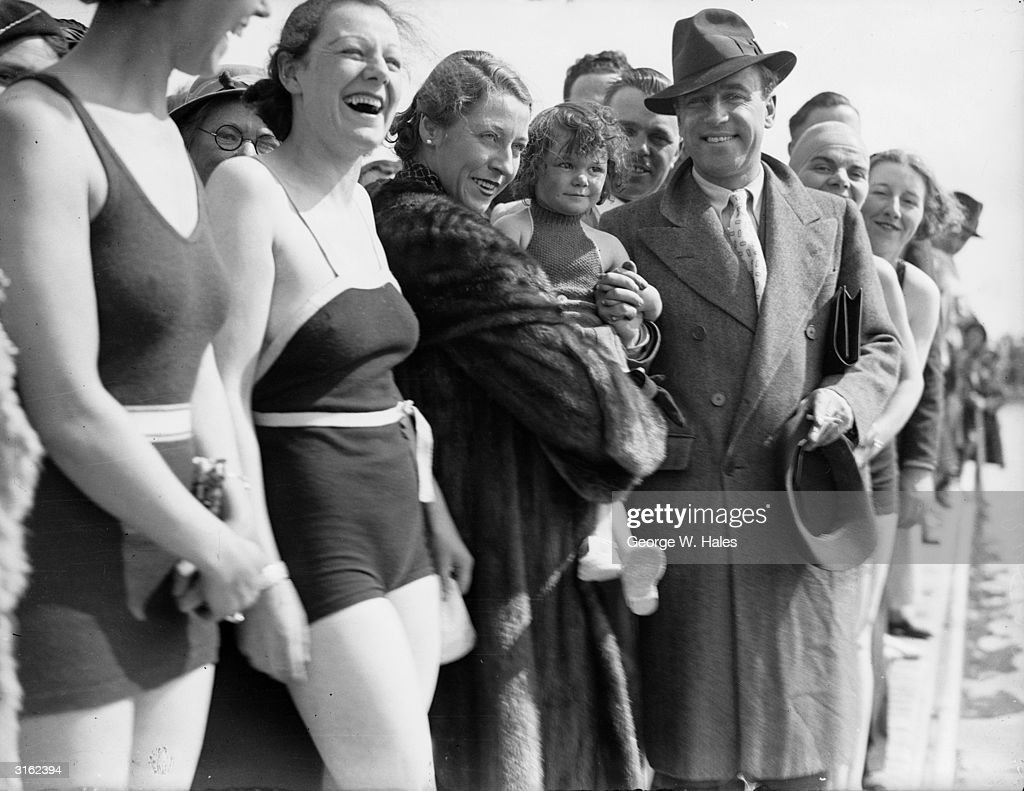 Aviators Amy Johnson (1903 - 1981) and her husband Jim Mollison (1905 - 1959) open the bathing pool at Butlin's Holiday Camp in Skegness.