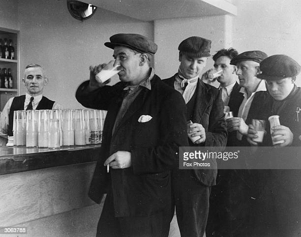 Miners from the Nook Colliery in Astley Lancashire enjoy a drink at the colliery's new milk bar after a day's work