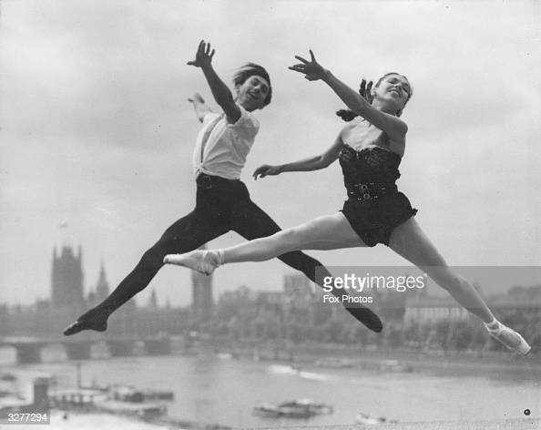 Cast members of the Festival Ballet rehearsing at the Royal Festival Hall on the South Bank with the Houses of Parliament across the River Thames in...