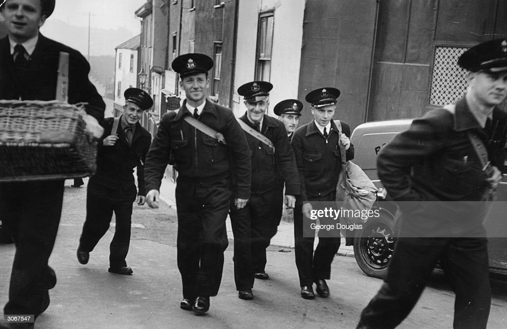 Postmen in Exeter setting out on their rounds in their new uniforms. Original Publication: Picture Post - 5875 - The New P.O. Uniforms - pub. 1952