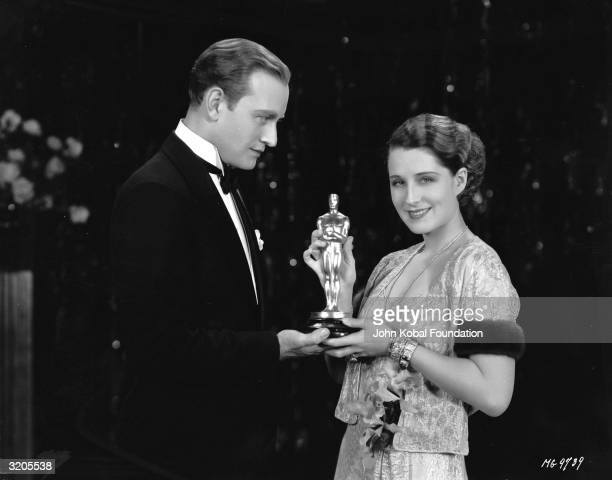 Canadian star Norma Shearer receives a Best Actress Oscar from Conrad Nagel for her role in 'The Divorcee' The two costarred as lovers in the film...