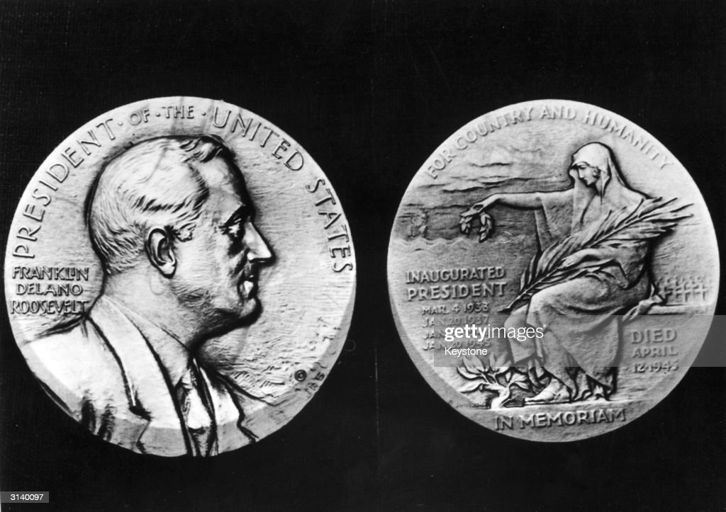 A reproduction of the Franklin Delano Roosevelt memorial medal engraved by John R Sinnock after his death. The medal features a portrait of the late President and on the other side a draped female figure representing a sorrowful nation, his four inauguration dates, the date of his death and the motto 'For Country And Humanity'.