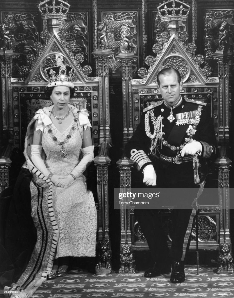 Queen Elizabeth II and the Duke of Edinburgh on their thrones in the Chamber of the House of Lords for the State Opening of Parliament