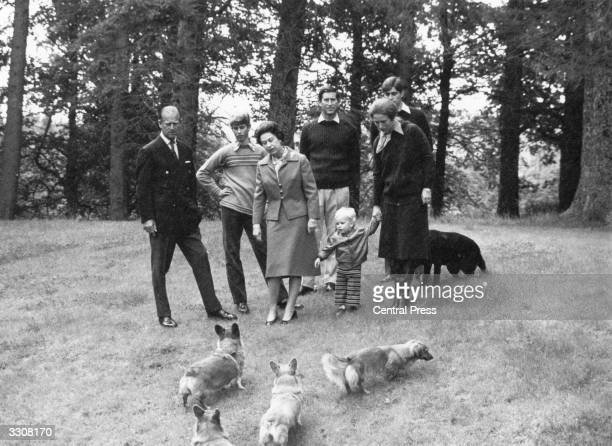 Members of the British Monarchy walking their dogs in a wood The Prince Philip Duke of Edinburgh Prince Edward Queen Elizabeth II Charles Prince of...