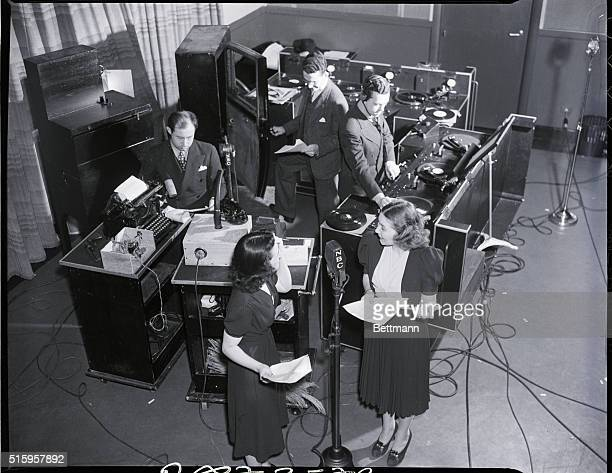 Sound Effects men {lr Segal Padgett and Monroe} are providing a suitable background for the microphone drama that radio actresses Mary Francis Garden...
