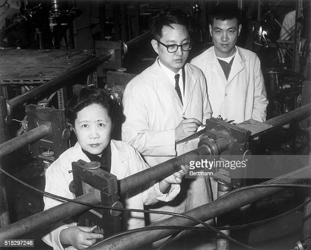 3/21/1963New YorkNY Left to right Professor ChienShiung Wu Dr YK Lee and L W Mo her associates conducting experiments The professor has conclusively...