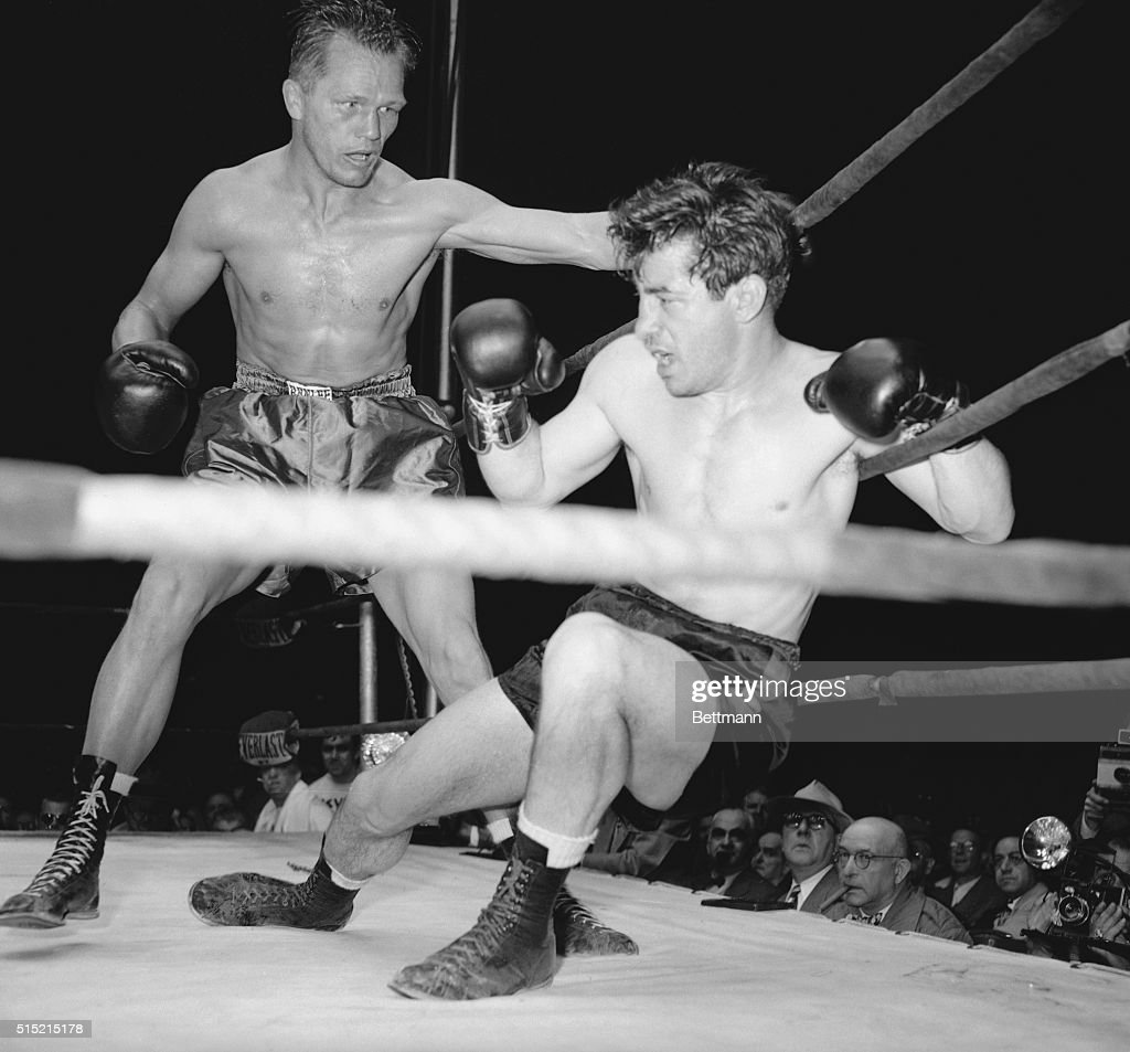 3/2/1948Newark NJ Clinging to the Ropes Rocky Graziano puts up his right arm to ward off a right by Tony Zale moving in for the kill in the third...