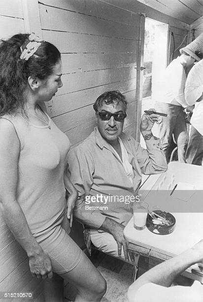 3/2/1967Bimini The Bahamas Former Congressman Adam Clayton Powell looks up from his domino game to view the attributes of Princess Tanya a 24yearold...